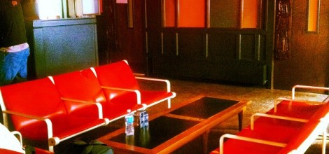 Red sofas inside the lounge